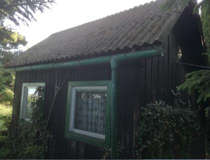 Blockhaus mit Weingarten